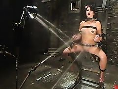 riley is bound and sprayed with hoses