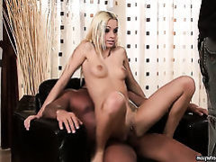 Blonde Erica Fontes plays with her soaking wet
