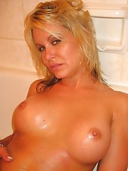 Sensuous blonde with perky tits screwed in the shower