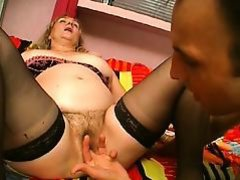 Guy sucks and takes chunky slut's strap-on on couch