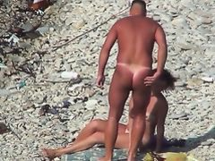 Voyeur. Guy with tanned ass fuck a woman at a public beach