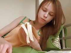 beata eats her banana and stuffs her pussy