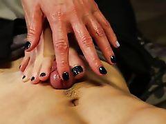 maitresse gives feetjob to her bond