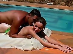 Appealing leggy girlie Yasmin stays topless after swimming in a pool. That babe is poses on knees