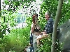 redheaded granny sucks off mature daddy in the woods